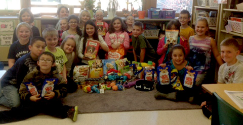 third graders pose with donations