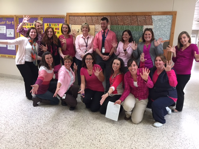 group photo of staff dressed in pink