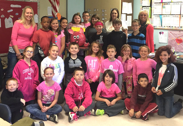 class dressed in pink with pink pig pumpkin
