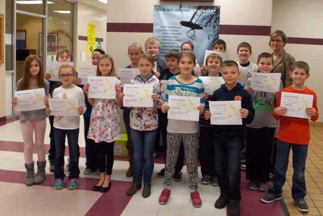group photo of students with certificates