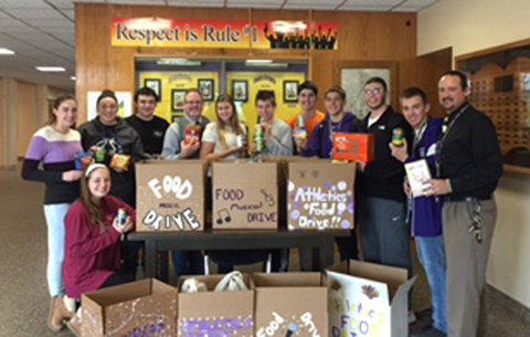 Dr. Fraser, Mr. Robare and students with food drive boxes