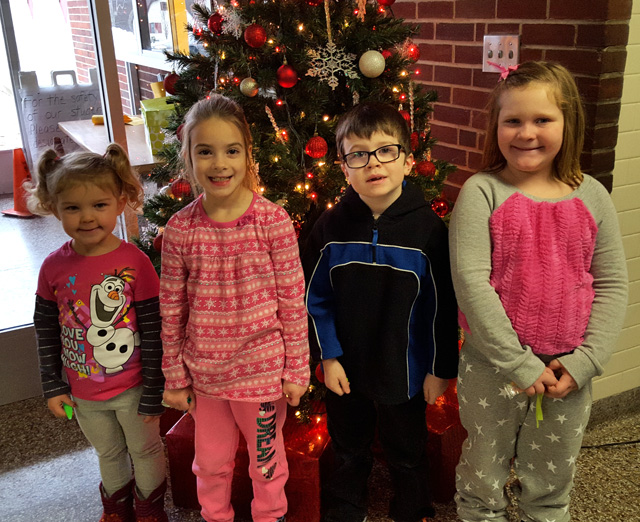 december box top winners in front of christmas tree