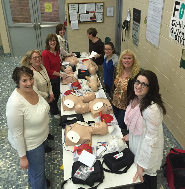 nurses at tables with cpr dummies