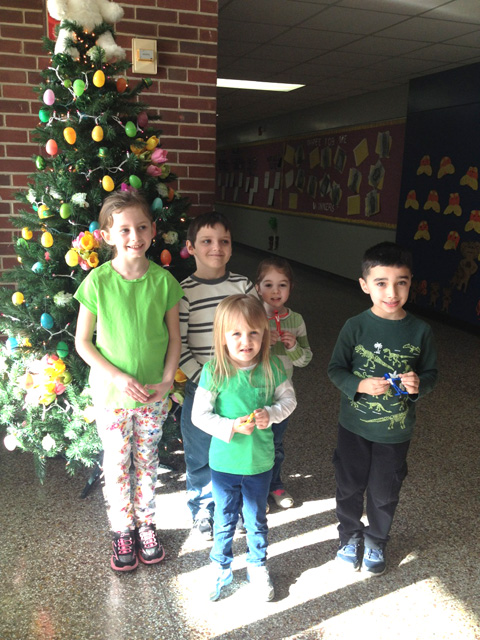 students in front of Easter egg tree