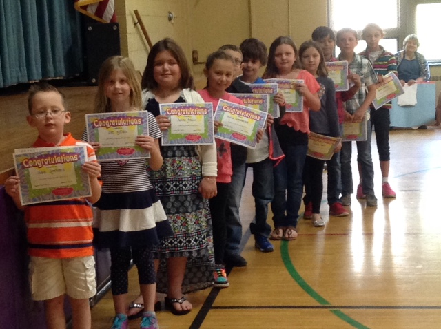 students line up in gym with certificates