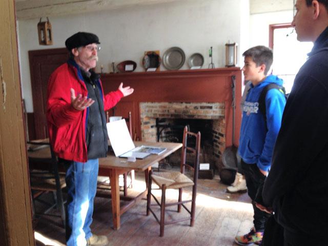 Noel Levee speaking with students