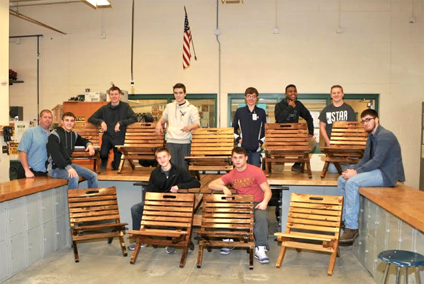 teacher and nine students pose with completed chairs