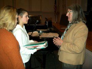 former Mayor Slingerland speaks with two girls