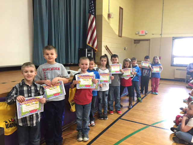 group shot of students of the month standing in a long line