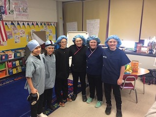 group of students with surgical caps on