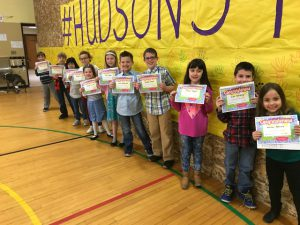 students of the month line up for group photo