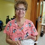 school nurse holding gift from JTA