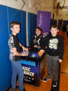 boys at music maker exhibit