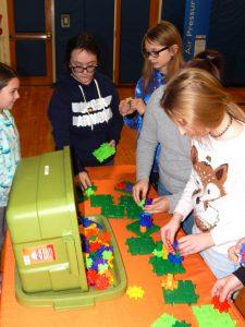 girls with lego type blocks