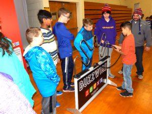 students line up around panel