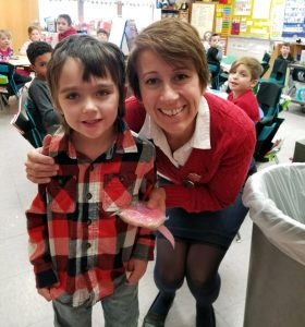 boy in plaid shirt with teacher Mrs. Lisicki