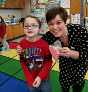 boy in red shirt and glasses with teacher Mrs. Livingstone