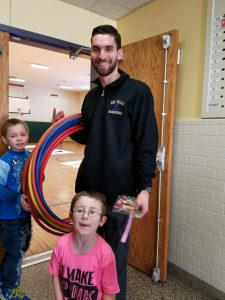 two boys with PE teacher Mr. Satterlee