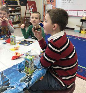 three boys eating