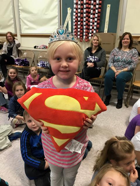 girl holding superman shield
