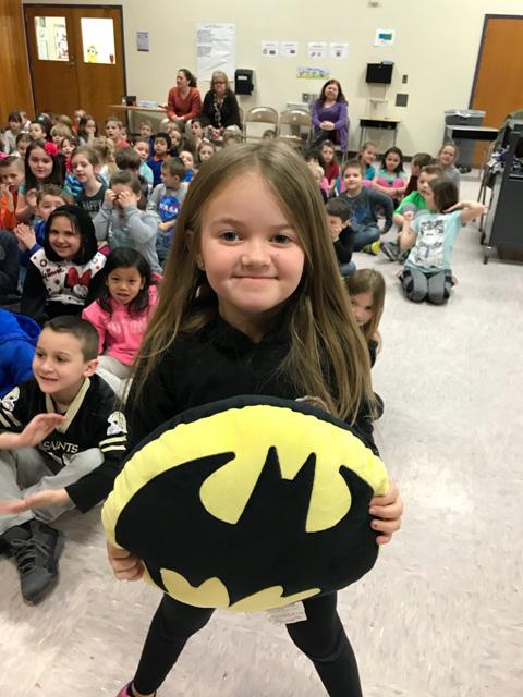 girl holding batman shield