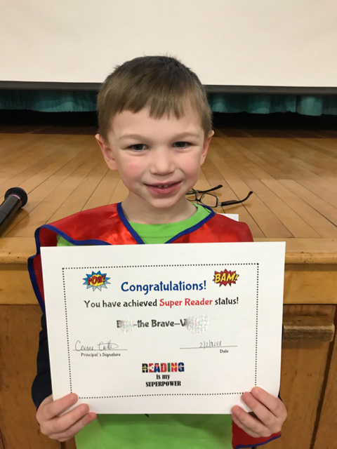 Boy with certificate and red cape
