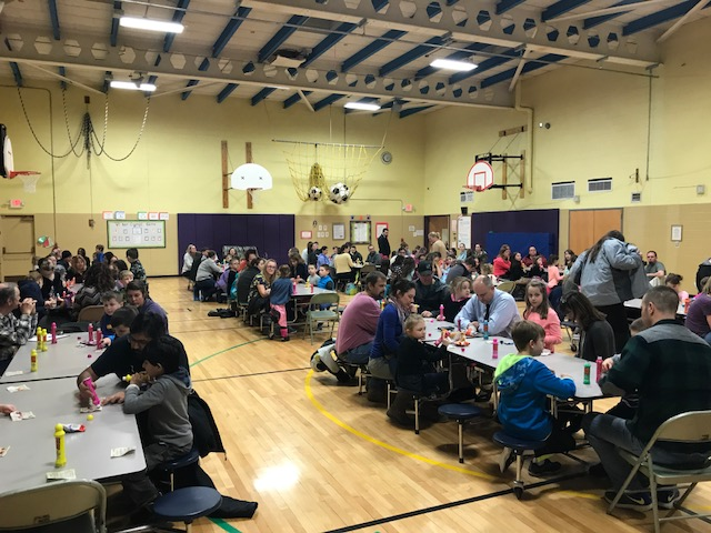 people fill tables in the gym to play BINGO