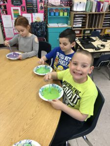 students with bowls of different colored slime