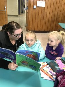 mother and 2 daughters reading