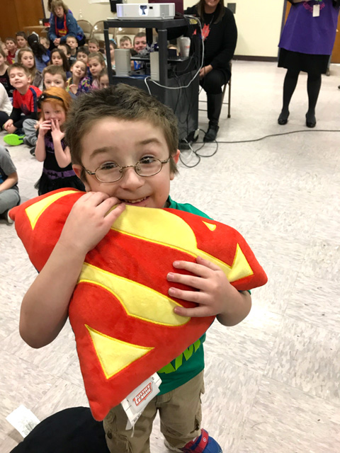 boy holding superman shield