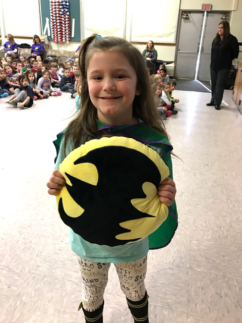 girl holding batman shield