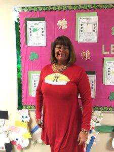 staff member with Pi symbol on shirt