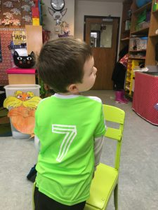 boy with number on back of his shirt