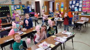 kids in classrooms hold up cotton candy