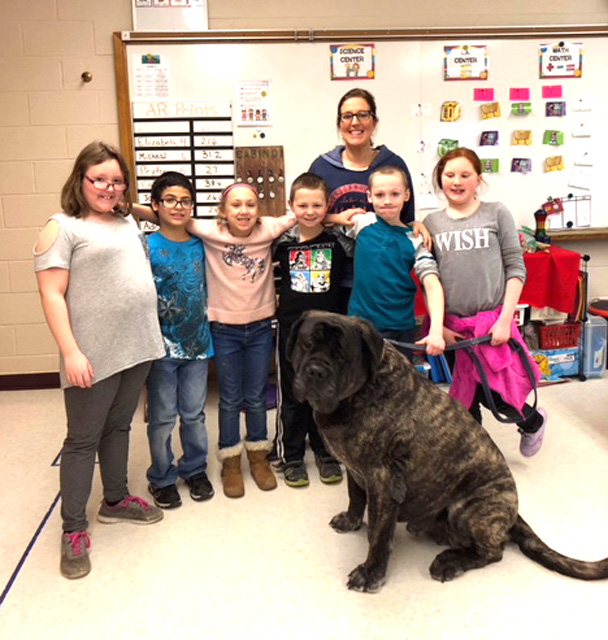 group photo of students with large dog
