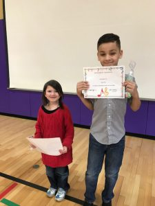 girl and boy hold Musician of the Month certificates