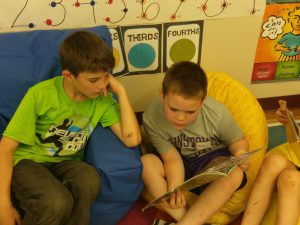 two more boys reading on bean bags
