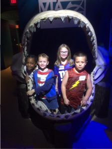 another bunch of kids in a shark mouth