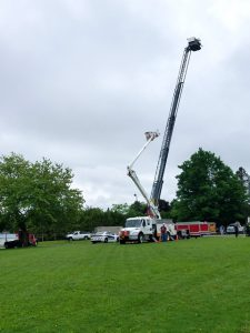 a bucket truck extended to the sky
