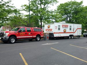 suburban towing a trailer for fire department