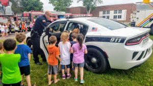 students look in a police cruiser