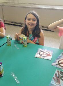 girl eating a sundae