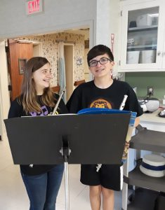 two students with flutes
