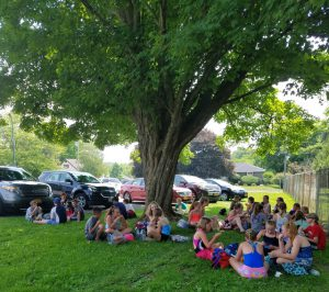 more students under a shade tree