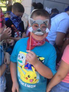 boy holding cat mask