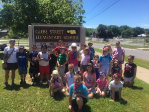 students in front of Glebe sign