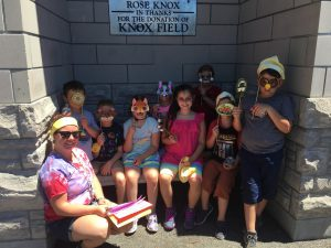 fourth group of kids by Rose Knox sign