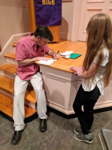 Mr. Preller signing a book for a students