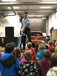 fireman demonstrates how to use a fire extinguisher