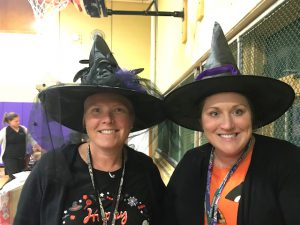 Mrs. Cotter and Mrs. North in witches hats